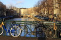 Bicycles lining a bridge over the canals of Amsterdam, Netherlands Royalty Free Stock Photo