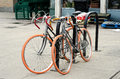 Bicycles parked in the city with orange tires Stock Photography