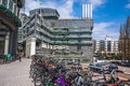 Bicycles parked near the new modern office building hamburg germany may large number of on may st in hamburg germany Stock Images