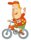 Bicycling abe the tourist waving while riding a bike Royalty Free Stock Photo