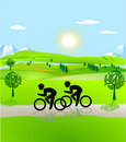 Bicycling and open landscape Royalty Free Stock Images