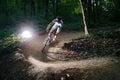 Bicyclist bikes forest