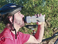 A Bicyclist Stops for a Water Break Royalty Free Stock Image