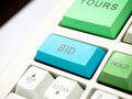 Bid button key on investment keyboard Stock Images