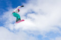 Big air girl female snowboarder making an awesome jump of a kicker Royalty Free Stock Photo