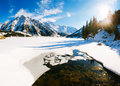 Big almaty lake on december water ice mountains and snow Royalty Free Stock Photos