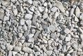 The big amount of light grey stones laying on the ground and white Royalty Free Stock Image