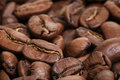 Big arabica coffee beans background close up macro photo Royalty Free Stock Image