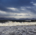 Big atlantic waves during a stormy weather in county kerry ireland picture taken from kells beach showing also fragment of the Stock Photography