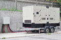 Big Backup Diesel Generator for Office Building Сonnected to the the Control Panel with Cable Wire Royalty Free Stock Photo