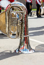 Big bass tuba on pavement background during the break of orchest Royalty Free Stock Photo