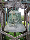 Big bell metal standing on wooden construction Royalty Free Stock Images