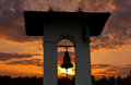 Big bell on sunset background Stock Image