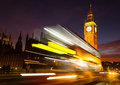 Big ben and a bus red at night showing motion blur Stock Photo