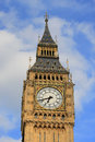 Big ben clock face top of tower london england view showing the and the ornate parts the on a clear sunny day Stock Images