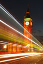 Big ben clock tower in the evening with traffic lights trails glowing on westminster bridge Stock Photography