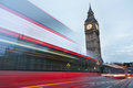 Big Ben in the early morning and red bus passing in London Royalty Free Stock Photo