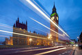 Big ben evening dabldekker passes leaves line light slow shutter speeds cityscape shot tilt shift lens maintaining verticals Stock Image
