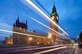 Big Ben behind light beams at twilight time, London, UK Royalty Free Stock Photo
