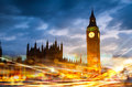 Big Ben and houses of Parliament with the traffic lights at night Royalty Free Stock Photo