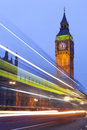 Big ben illuminated at night in london england lights of cars passing by can be seen in the photo Stock Photos