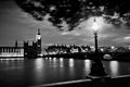 Big Ben, London the UK at sunset. Retro street lamp light on Westminster Bridge. Black and white Royalty Free Stock Photo