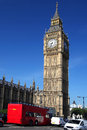 Big Ben with red bus in London, UK Royalty Free Stock Images