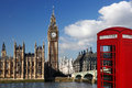 Big ben with red phone booth in london england a traditional box against Royalty Free Stock Images
