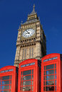 Big Ben with red phone boxes, London Stock Image