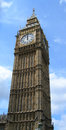 Big ben tower at oclock london clock striking noon in england uk Royalty Free Stock Image