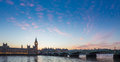 Big Ben and Westminster Bridge and Parliament with colorful clouds at dusk, London, UK Royalty Free Stock Photo