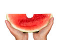 Big bite out of watermelon great shot hands holding a slice with a it horizontal shot isolated on a white background Royalty Free Stock Photos