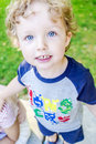 Big blue eyes of one happy boy on his walk in a park Royalty Free Stock Images