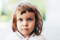 Big blue eyes portrait of a little cute girl with Royalty Free Stock Image