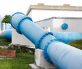Big blue steel pipes and couplings of an irrigation water Stock Photography