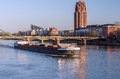Big boat under the bridge at sunset ship flows in river time in european city Stock Photography