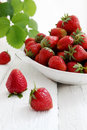 Big bowl of strawberries ripe juicy berries in a Royalty Free Stock Photos