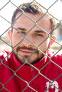 Big boy behind fence brunette standing inside brc bars in iraq Stock Image