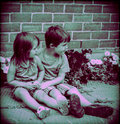 Big brother a and sister sitting on walking path showing their brotherly sisterly love for one another in an old school instagram Royalty Free Stock Photography