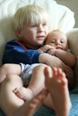 Big Brother Snuggling Baby Sister Royalty Free Stock Photo