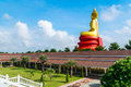 Big buddha and cloudy at temple Stock Photo