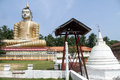 Big buddha statue of and dagoba in wewurukannala vihara sri lanka Royalty Free Stock Image