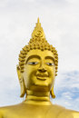 Big buddha statue smiling golden in thai temple Stock Photos