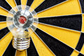 Big bulb target on bullseye with dartboard background Royalty Free Stock Photo