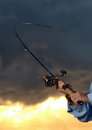 Big catch while fishing with rod and reel for recreation sunrise in background Royalty Free Stock Photography