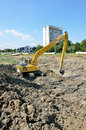 Big caterpillar excavator on construction site forward activity the river bed yellow cat clear the river bed from mud Royalty Free Stock Images