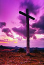 Big Christian cross standing on top of a hill Radobyl  in CHKO Ceske Stredohori area at evening after sunset  in czech summer land Royalty Free Stock Photo