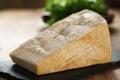Big chunk of italian parmesan cheese on slate board Royalty Free Stock Photo