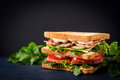 Big Club sandwich with ham, bacon, tomato, cucumber, cheese, eggs and herbs