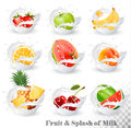 Big collection of fruit in a milk splash.
